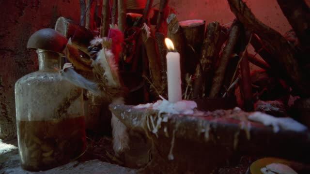 cu, voodoo altar, person taking bottle, havana, cuba  - schrein stock-videos und b-roll-filmmaterial