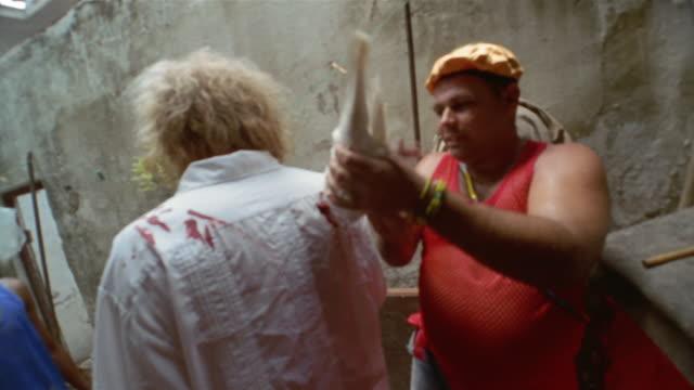 ms, voodoo ritual, priest waving dead dove up and down, man rotating, havana, cuba  - priest stock videos & royalty-free footage