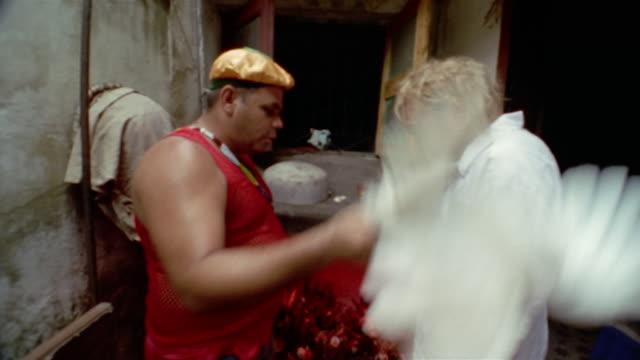 MS, Voodoo ritual, priest waving dove up and down, man rotating, Havana, Cuba