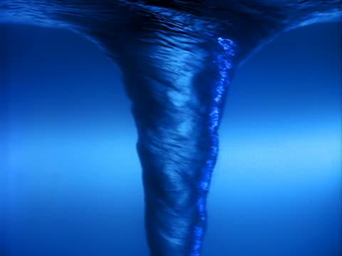 Vortex of swirling blue water