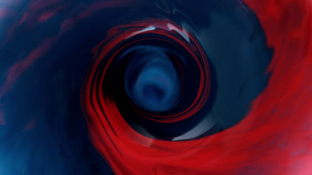 slo mo ld vortex swirling with red and blue colour - vortex stock videos & royalty-free footage