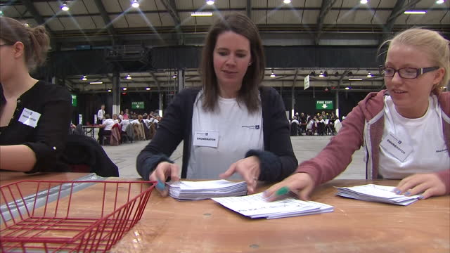 Vote counting underway in Aberdeen after day at the polls Shows interior shots votes being counted in Aberdeen anonymous flicking through ballot...