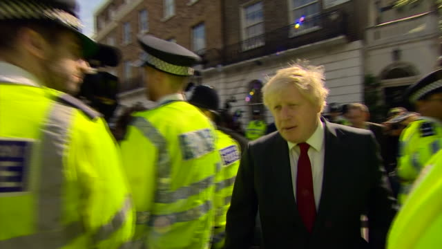 Vote Leave campaigner Boris Johnson being booed and heckled by angry crowds as he leaves his house the morning after Brexit