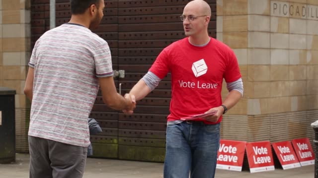 vote leave campaigners hand out promotional materials and talk to the public in manchester uk on saturday june 11 2016 - 2016 stock videos & royalty-free footage