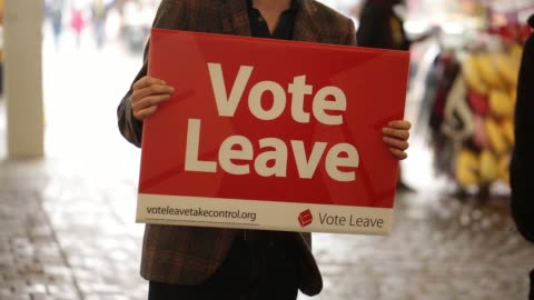 vote leave campaigners hand out promotional materials and talk to the public in manchester, u.k., on saturday, june 11, 2016 - 2016 stock videos & royalty-free footage