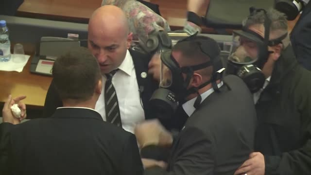 A vote on a border deal with Montenegro in the Kosovo parliament is interrupted as tear gas is lobbed into the chamber