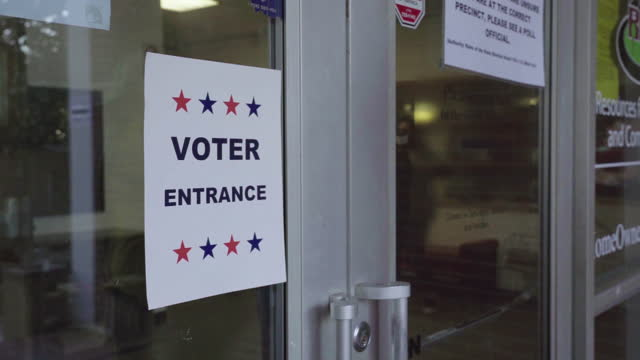 voter entrance sign at a polling place during senate runoff election in atlanta, ga, u.s. on january 05, 2021. polls have opened across georgia in... - star shape stock videos & royalty-free footage
