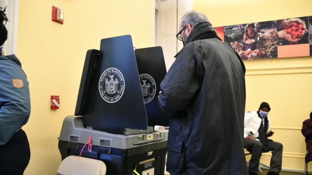 voter wearing a protective mask gestures after casting his ballot on election day 2020 at the tweed courthouse poll site in lower manhattan on... - joe 03 stock videos & royalty-free footage