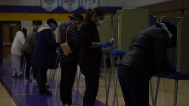 voters and volunteers at washington high school polling station in milwaukee wisconsin usa on tuesday april 7 2020 - wisconsin stock videos & royalty-free footage