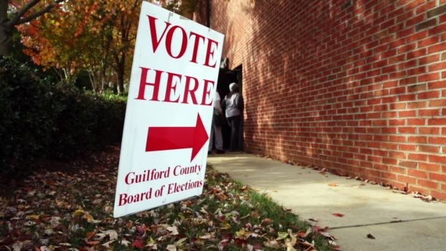 voters arrive at the polling place at white oak grove baptist church to cast their ballots on election day greensboro nc november 4 2014 - polling place stock videos & royalty-free footage