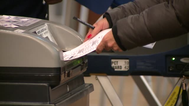 voters at polling station for chicago municipal elections on february 27, 2019. - ballot slip stock videos & royalty-free footage