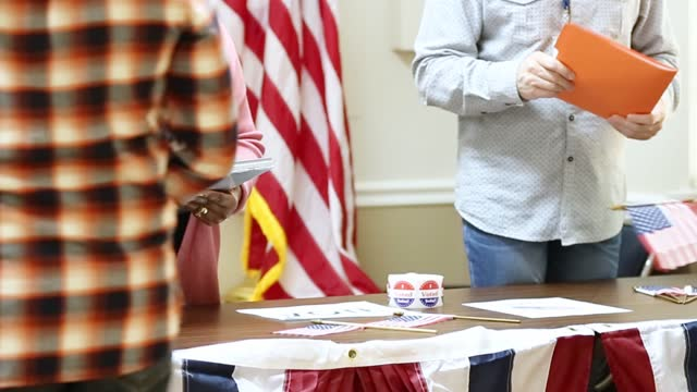 voters at the check in table at polling precinct.  usa election. - local politics stock videos & royalty-free footage