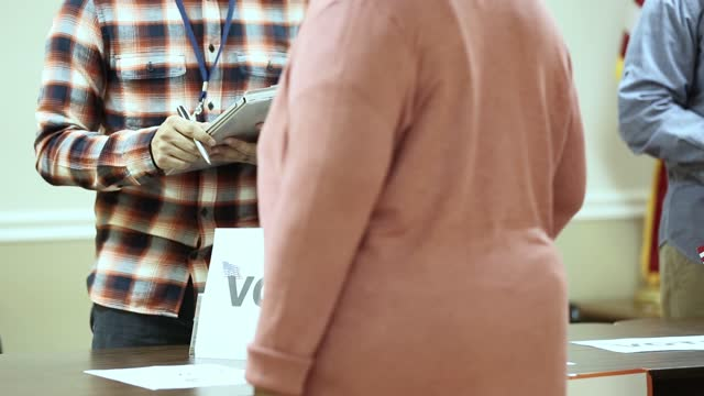 voters at the check in table at polling precinct.  usa election. - indian politics stock videos & royalty-free footage