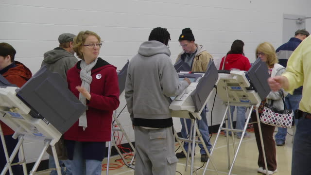 ms pan voters cast ballots at computer terminals during presidential election / sylvania, ohio, united states  - stimmabgabe stock-videos und b-roll-filmmaterial