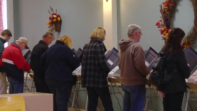 ms pan voters cast ballots at copmuter terminals during voting in presidential election / monclova, ohio, united states - 投票点の映像素材/bロール