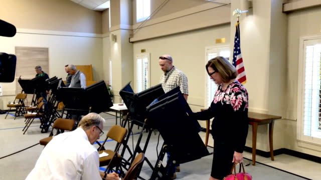 voters cast their ballots at a polling station at hillsboro presbyterian church on election day, november 6, 2018 in nashville, tennessee. americans... - midterm election stock videos & royalty-free footage