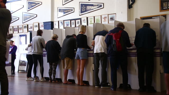 voters cast their ballots at a polling station during a federal election in sydney australia on saturday may 18 2019 - voting booth stock videos & royalty-free footage