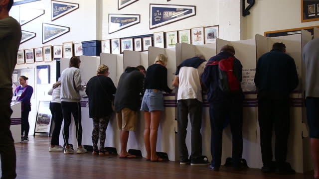 voters cast their ballots at a polling station during a federal election in sydney australia on saturday may 18 2019 - patriotism stock videos & royalty-free footage