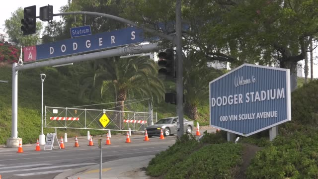 voters cast their ballots at dodger stadium on election day on november 3, 2020 in los angeles. a record number of californians voted in this year's... - 米国大統領選挙点の映像素材/bロール