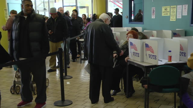 MS PAN Voters cast their ballots at early voting place five days before presidential election / Toledo, Ohio, United States
