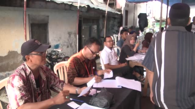 voters cast their ballots during the election day to elect jakarta governor to a fiveyear term in jakarta indonesia on february 15 2017 incumbent... - wahlurne stock-videos und b-roll-filmmaterial