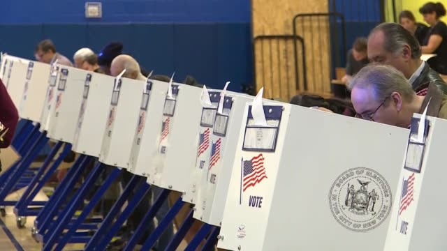 voters cast their ballots during the midterm election at a polling station in new york united states on november 06 2018 americans are descending on... - 投票点の映像素材/bロール