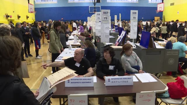 voters cast their ballots during the midterm election at a polling station in new york, united states on november 06, 2018. americans are descending... - voting stock videos & royalty-free footage