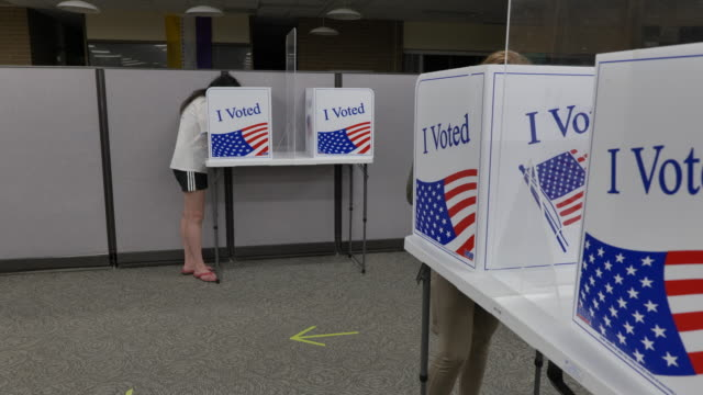 voters cast their ballots during the us presidential election on october 22nd, 2020 in arlington, virginia, usa. - election stock videos & royalty-free footage