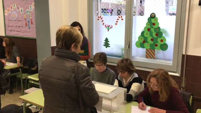 Voters cast their ballots for the Catalan regional election at a polling station in Barcelona on December 21 2017