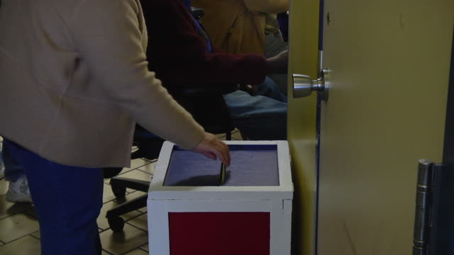 ms voters deposit their completed ballots at early voting location five days before presidential election / toledo, ohio, united states - voting ballot stock videos and b-roll footage
