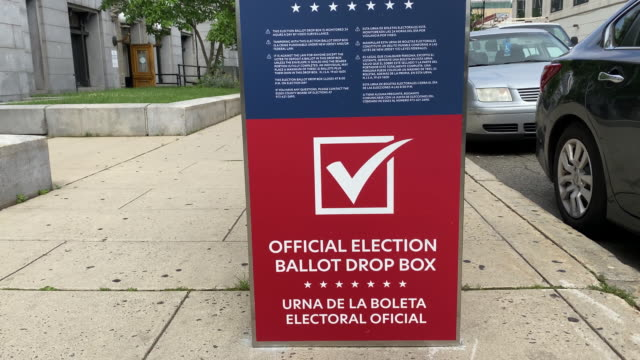 voters drop off ballots at ballot drop off boxes and vote at polling places during primary election day in newark new jersey us on tuesday july 7 2020 - voting ballot stock videos & royalty-free footage