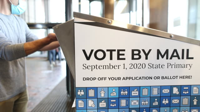 voters drop their ballots off in a vote by mail box on primary day on tuesday, september 1, 2020 in boston, mass., usa. all eyes are on whether... - ballot box stock videos & royalty-free footage