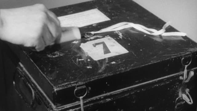 stockvideo's en b-roll-footage met montage voters dropping ballots into ballot box, and box being opened and ballots dumped out / united kingdom - stembus