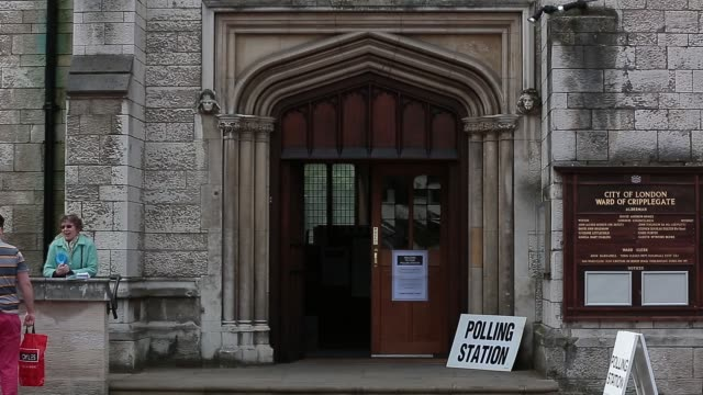 voters enter a polling station to cast their votes in the general election in london uk on thursday may 7 2015 shots polling station signage - allgemeine wahlen stock-videos und b-roll-filmmaterial