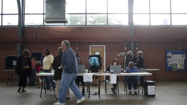 voters enter and exit a polling place at a south carolina national guard armory on the morning of the south carolina republican presidential primary... - polling place stock videos & royalty-free footage