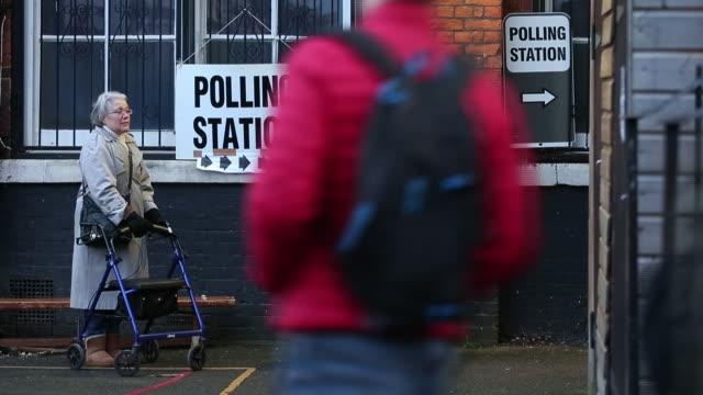 voters entering polling station during uk general election london england uk on thursday december 12 2019 - registration stock videos & royalty-free footage