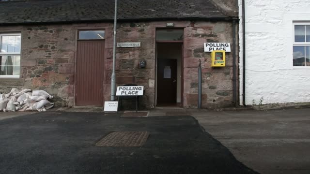 voters exit a polling station after casting their votes in the european union referendum at the penpont polling station in dumfries and galloway uk... - 国民投票点の映像素材/bロール