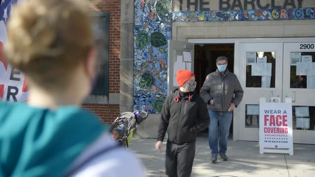 voters exit the barclay school in baltimore maryland - over the shoulder stock videos & royalty-free footage
