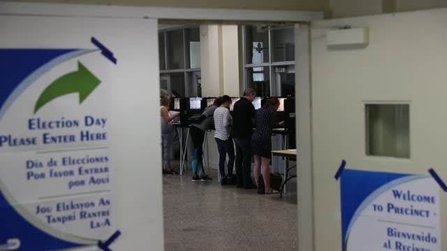 stockvideo's en b-roll-footage met voters fill out their ballots as they cast their vote at a polling station setup in legion park for the midterm election on november 06 2018 in miami... - stembus