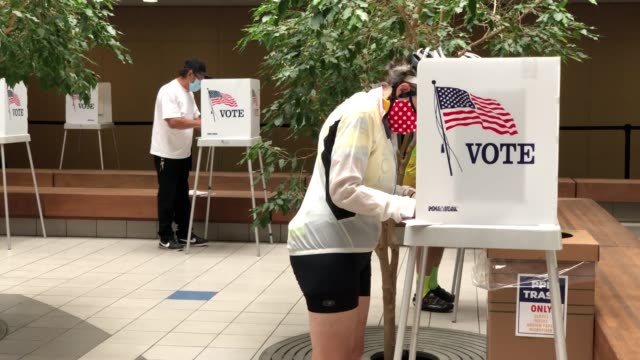 voters fill out their ballots as they vote early at the santa clara county registrar of voters office on october 13, 2020 in san jose, california.... - ballot box stock videos & royalty-free footage