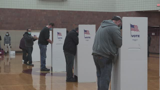voters fill out their ballots in the 2020 presidential election on november 3, 2020 in hamtramck, michigan. hamtramck is a muslim-majority and has a... - michigan stock videos & royalty-free footage