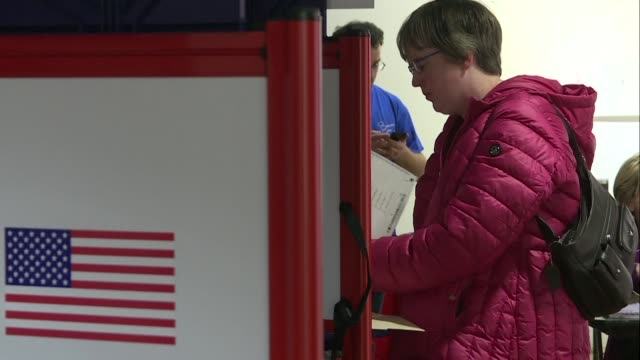 voters in arlington virginia cast their ballots to select the democratic candidate who will face donald trump in the 2020 presidential race - arlington virginia stock videos & royalty-free footage