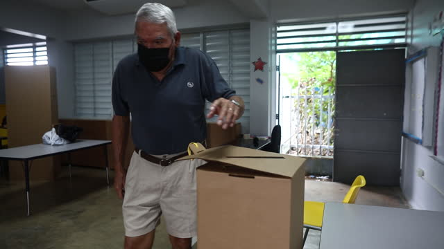 voters in face masks casting ballots for 2021 puerto rican congressional delegation election. in san juan, puerto rico, on sunday, may 16, 2021. - puerto rican ethnicity stock videos & royalty-free footage