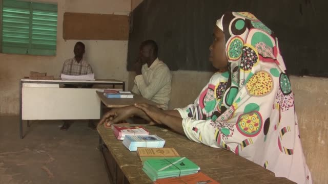voters in niger go to the polls in an election in which president mahamadou issoufou has promised a knockout blow to his opponents one of whom is... - mahamadou issoufou stock videos and b-roll footage