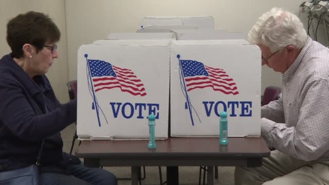voters in toledo head to the polls early as candidates hillary clinton and donald trump prepare for their third and final presidential debate in las... - ohio stock videos & royalty-free footage