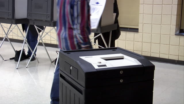ms, voters in voting booths, mid section, ballot box in foreground, ypsilanti, michigan, usa - ypsilanti stock videos & royalty-free footage