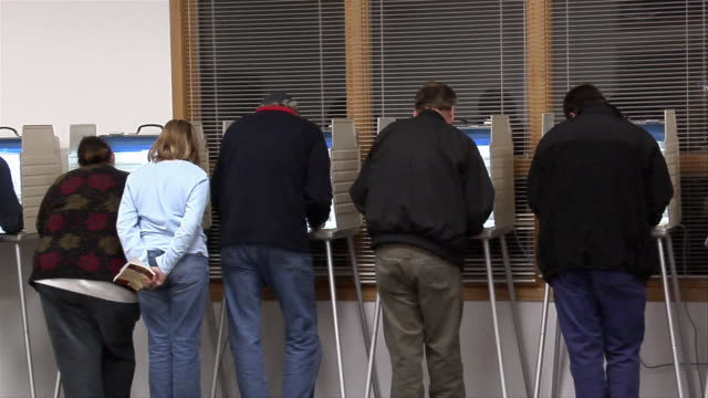 ms, pan, voters in voting booths, rear view, ypsilanti, michigan, usa - ypsilanti stock videos & royalty-free footage