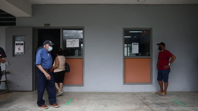 voters leaving polling place after voting in 2021 puerto rican congressional delegation election. in san juan, puerto rico, on sunday, may 16, 2021. - puerto rican ethnicity stock videos & royalty-free footage