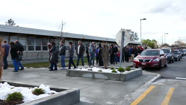 voters line up at stansbury elementary school's democratic caucus site to vote in the primary elections - vorwahl stock-videos und b-roll-filmmaterial