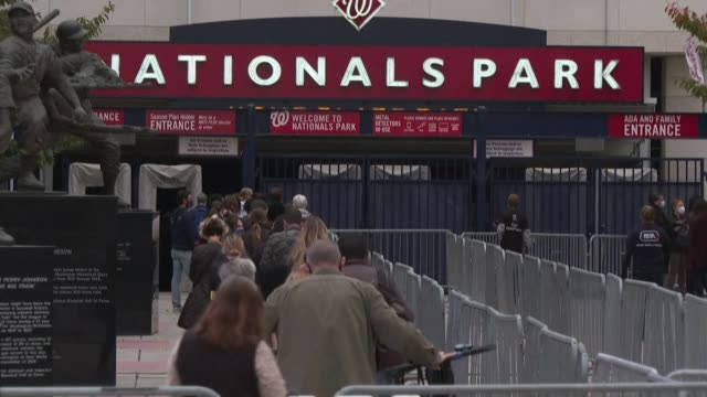 voters line up outside the nationals park baseball field in washington, dc, as early voting begins in the us capital - nationals park stock videos & royalty-free footage
